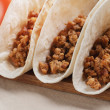Closeup of three tacos with minced meat — Stock Photo #62426061