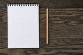 Blank notepad with  pencil on  wooden table — Stock Photo
