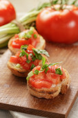 Italian bruschetta with tomatoes onion and basil — Stock Photo