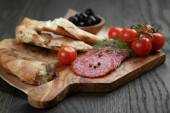 Antipasti with salami, olives, tomatoes and bread — Stock Photo