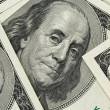 Lots of one hundred dollar banknotes, background — Stock Photo #63655107