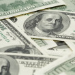 Lots of one hundred dollar banknotes, background — Stock Photo #63655133