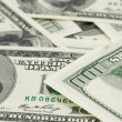 Lots of one hundred dollar banknotes, background — Stock Photo #63655165