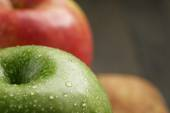 Two ripe apples on olive cutting board — Stock Photo