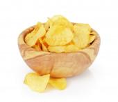 Heap of organic potato chips isolated on white — Stock Photo