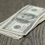Hundred dollar bills on wooden table — Stock Photo #71165033