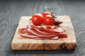 Smoked ham prsut with cherry tomatoes and chili — ストック写真