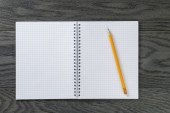 Blank notepad with pencil on gray wood table — Stock Photo