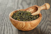 Oolong green tea in wood bowl — Stock Photo