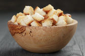 Homemade croutons from white bread in wood bowl — Stock Photo