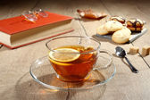 Tea cup  on wooden table — Stock Photo