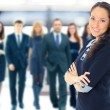 Face of beautiful woman on the background of business people — Stock Photo #52867211