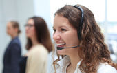 Young employee working with a headset — Stock Photo