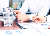 Business adviser analyzing financial figures — Stock Photo