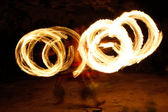 Fire show in famous Hina cave, blurred motion, Oholei beach, Ton — Stock Photo