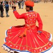 Indian man in traditional dress dancing at Desert Festival, Jais — Stock Photo #55028479