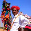 Indian man standing with his decorated camel at Desert Festival, — Stock Photo #55121723