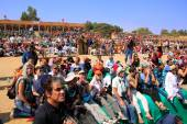 Local people and tourists watching Desert Festival performance, — Stock Photo