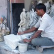 Man working on a statue at a workshop in Delhi, India — Stock Photo #68539737