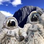 Постер, плакат: Astronauts on a rocky landscape