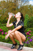 Beautiful young woman drinking water — Stok fotoğraf