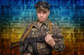 Soldier with a gun in hand — Stock Photo