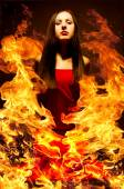 Portrait of a beautiful young woman on fire — Stock Photo