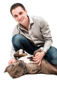 Happy man with a pitbull puppy — Stock Photo