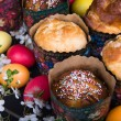 Easter sweet breads with colorful eggs and cherry branches — Stock Photo #53323095