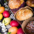 Easter sweet breads with colorful eggs and cherry branches — Stock Photo #53323133