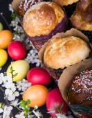 Easter sweet breads with colorful eggs and cherry branches — Stock Photo