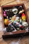 Christmas decorations in the old wooden box — Stock Photo