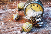 Outdated watches on the background of Christmas tree decorations — Stock Photo