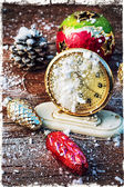 Watches on the background of Christmas tree decorations — Stock Photo