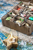 Outdated Christmas toys in cardboard box — Stock Photo