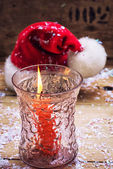 Christmas bell and candle — Stock Photo