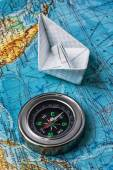 Outdated marine compass on a topographic map — Stock Photo