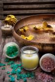 Bronze bowl with water and accessories spa treatments — Stock Photo