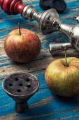Accessories for Shisha on the background of two ripe apples — Stock Photo