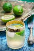 Alcoholic cocktail with additions of lime — Stock Photo