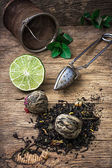 Tea brew with lime and mint on wooden background — Stock Photo