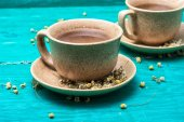 Tea brewed with chamomile in ceramic mugs — Stock Photo