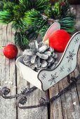 Christmas card with sleigh and ornaments — Stock Photo