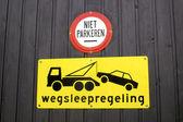 Dutch tow away sign on a garage door — Stock Photo