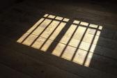 Sunlight on wooden floor — Stock Photo