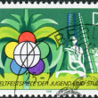 Postage stamp printed in Germany (GDR), dedicated to 11th World Youth Festival, Havana, shows Festival Emblem and New Buildings — Stock Photo #52153753