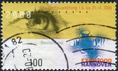 Postage stamp printed in Germany, dedicated to the EXPO 2000, Hannover, depicts the eye and emblem — Stockfoto