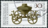 Postage stamp printed in Germany, shows the Archaeological Treasures: Bronze ritual chariot c. 1000 B.C. — Stock Photo