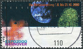 Postage stamp printed in Germany, dedicated to the EXPO 2000, Hannover, depicts Earth, fingerprint and emblem — Stockfoto