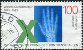 Postage stamp printed in Germany, dedicated to the 150th anniversary of Wilhelm Conrad Roentgen, discoverer of X-rays — Foto Stock